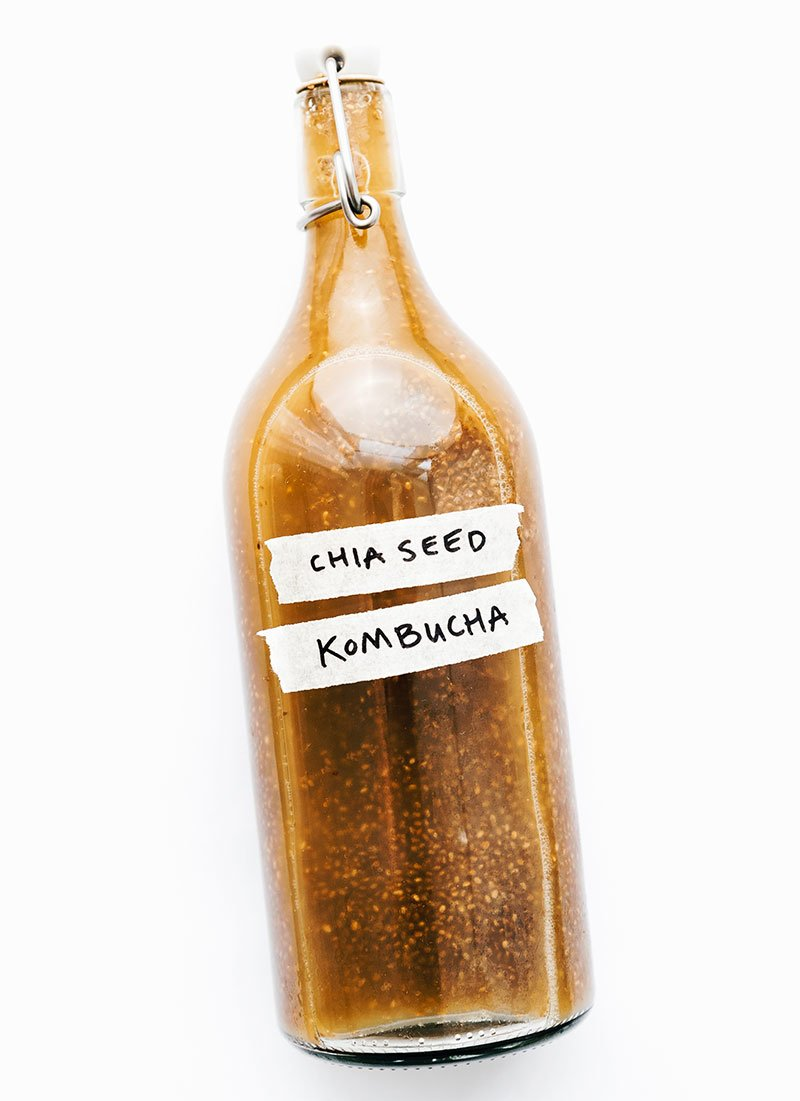 Bottle of chia seed kombucha on white background