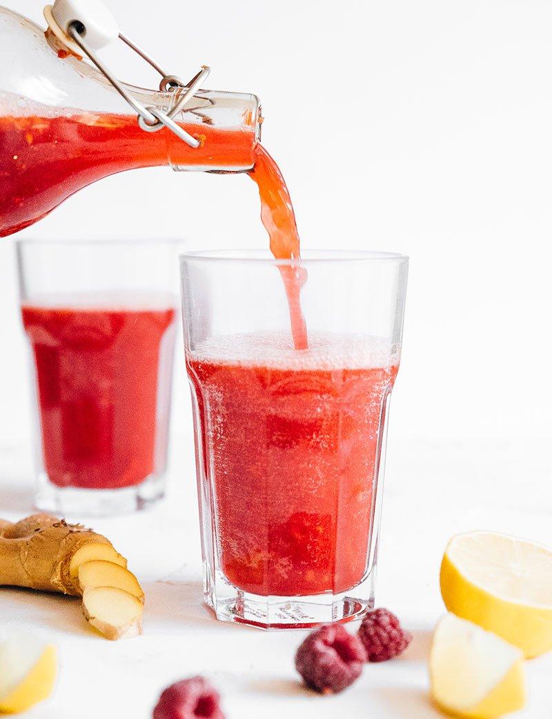 Trilogy copycat raspberry lemon kombucha in glasses on white background