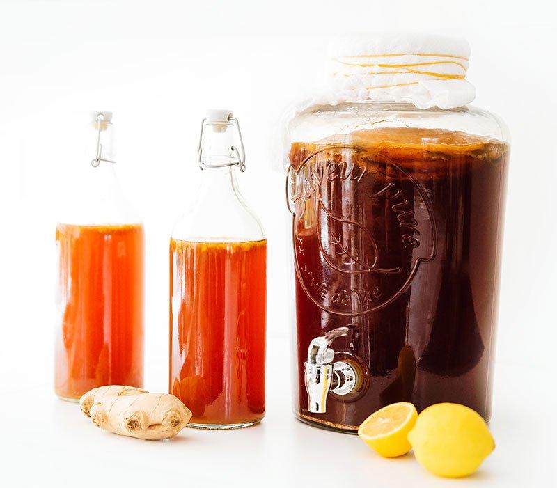 lemons, ginger, and kombucha in bottles