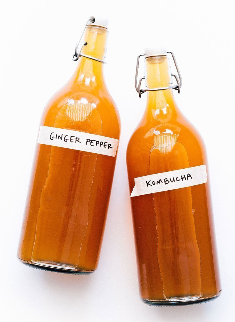 ginger pepper kombucha in fermentation bottles