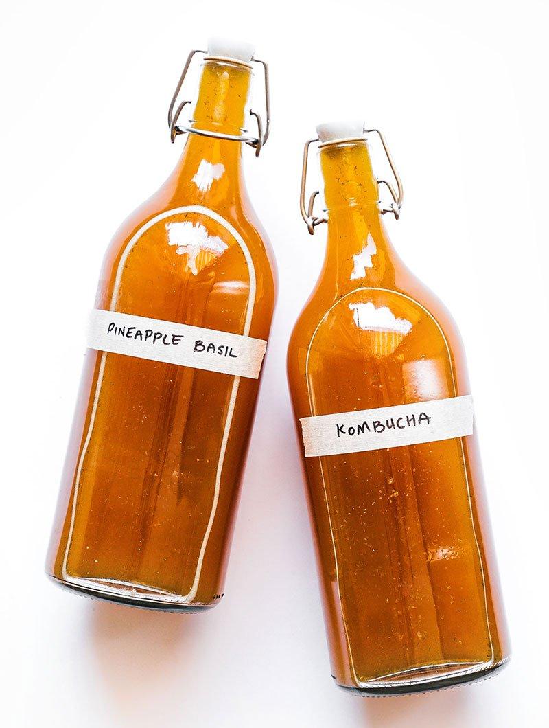pineapple basil kombucha in fermentation bottles
