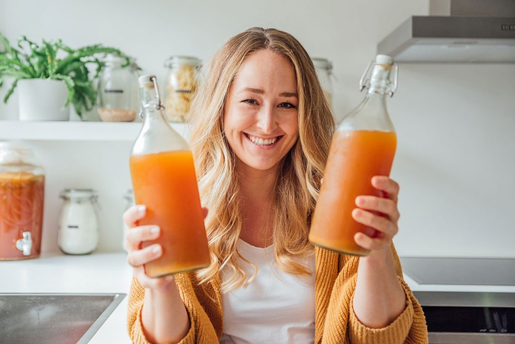 Sarah Bond with bottles of kombucha