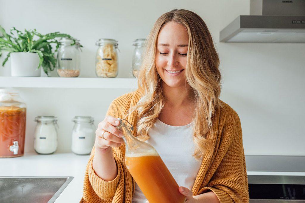 Sarah Bond with bottle of kombucha