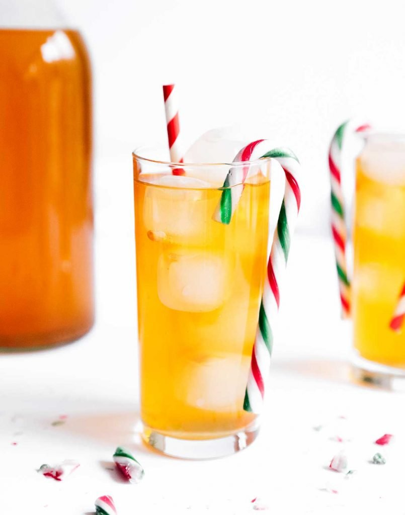 Kombucha in a glass with a candy cane
