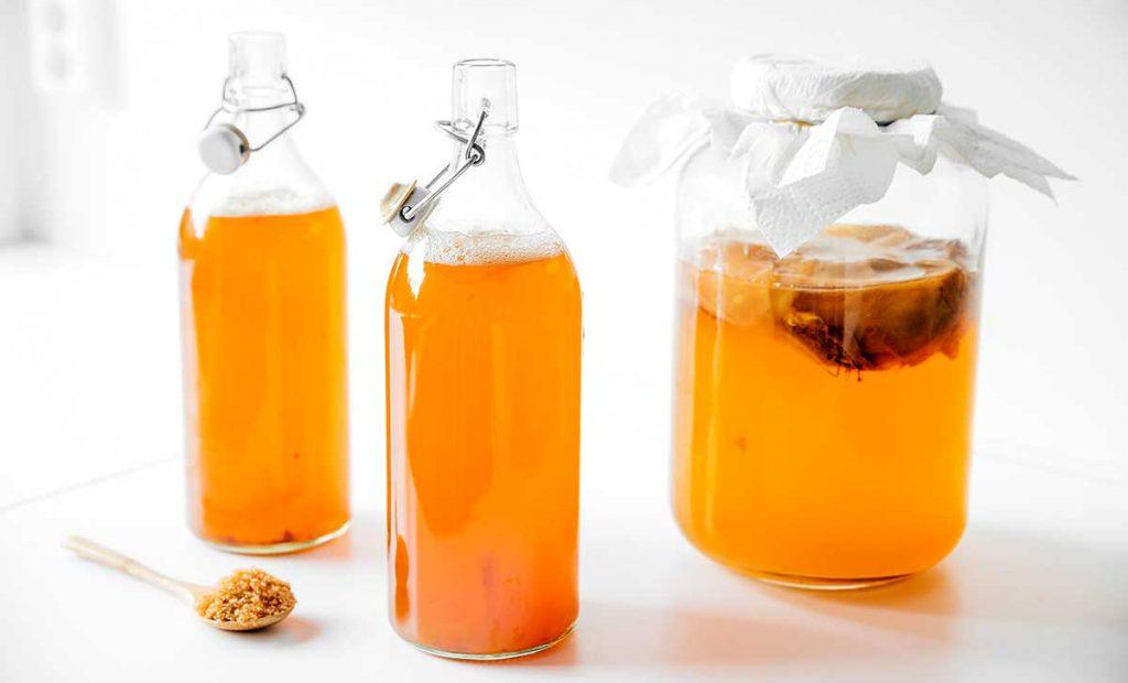 Brown sugar and vanilla kombucha in fermentation bottles
